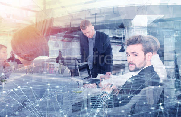 Business people that work together in office with network effects. Concept of teamwork and partnersh Stock photo © alphaspirit