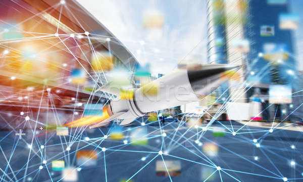 Rocket fly fast with internet connection network background. concept of startup and growing company Stock photo © alphaspirit