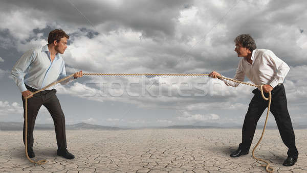 Businessman and pull the rope Stock photo © alphaspirit