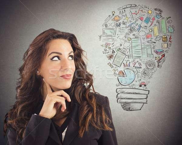 Zakenvrouw complex idee naar gloeilamp Stockfoto © alphaspirit