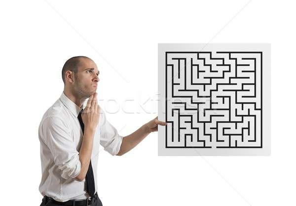 Businessman with maze Stock photo © alphaspirit