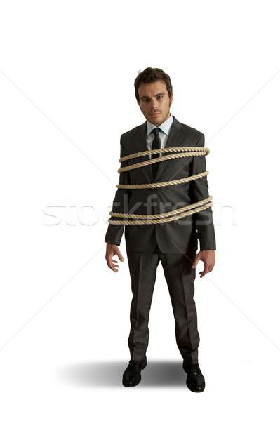 Businessman tied up with rope Stock photo © alphaspirit