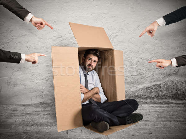 Guilty businessman indicated by colleagues Stock photo © alphaspirit