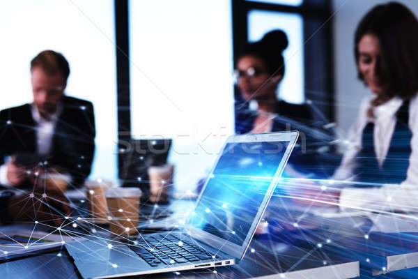 Teamwork works with a laptop. Concept of internet sharing and interconnection. double exposure Stock photo © alphaspirit