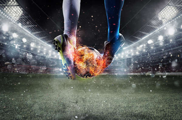 Soccer players with soccerball on fire at the stadium during the match Stock photo © alphaspirit