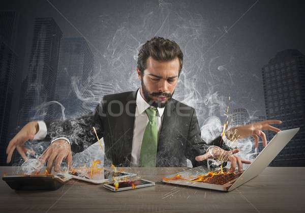 Overworked businessman Stock photo © alphaspirit