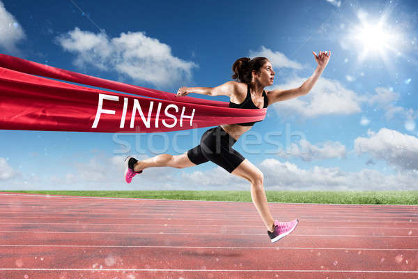 Winner woman runner on the finish line Stock photo © alphaspirit