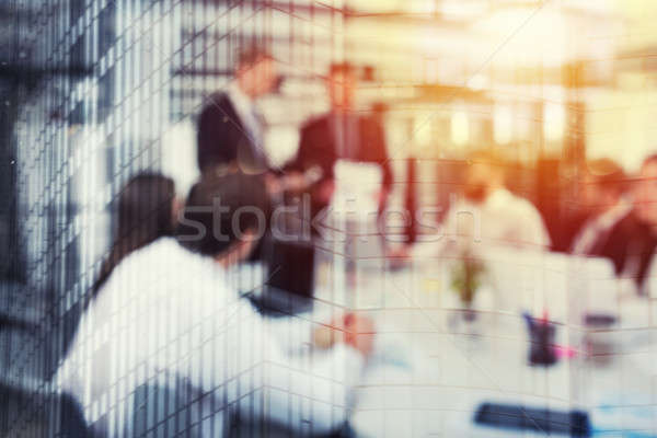 Blurred background of business people in office with futuristic effect Stock photo © alphaspirit