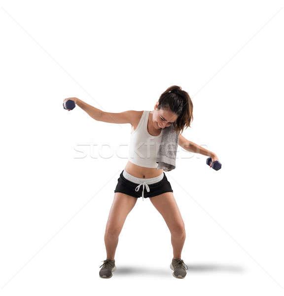 Training onhandig meisje lift gewichten vrouw Stockfoto © alphaspirit