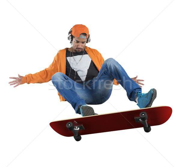 Street boy doing stunts with his skate Stock photo © alphaspirit