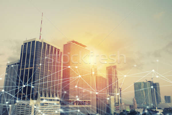 Headquarter of business company during sunrise with network connection effect Stock photo © alphaspirit