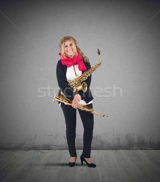 Músico trombeta instrumentos musicais mulher arte estrela Foto stock © alphaspirit