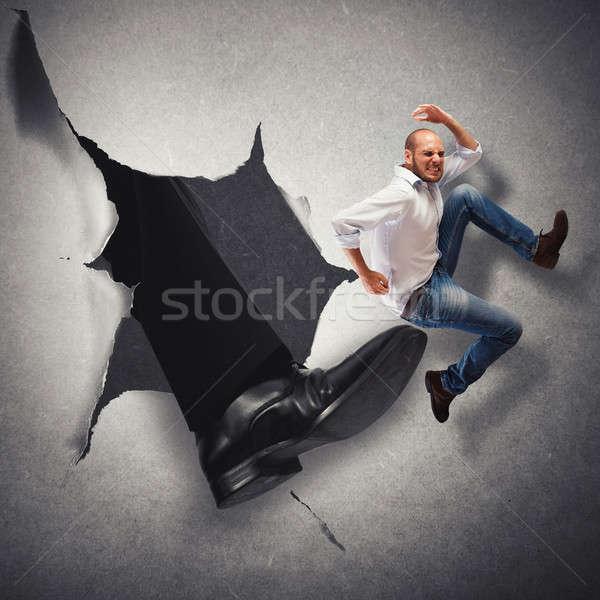 Alkalmazott férfi rúgás nagy láb üzletember Stock fotó © alphaspirit