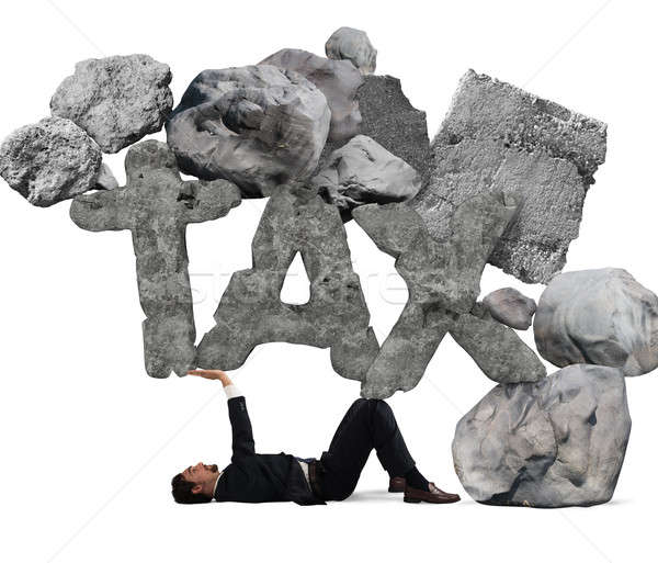 Crushed by the weight of taxes Stock photo © alphaspirit