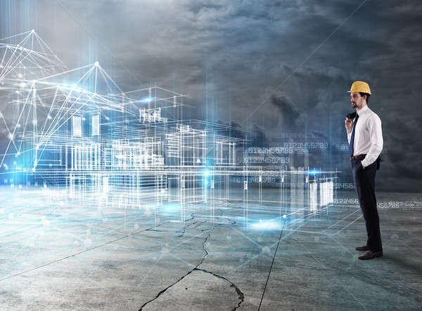 Businessman Architect analyzes a project of a building Stock photo © alphaspirit