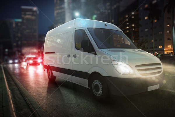 Fast van on a city road delivering at night. 3D Rendering Stock photo © alphaspirit
