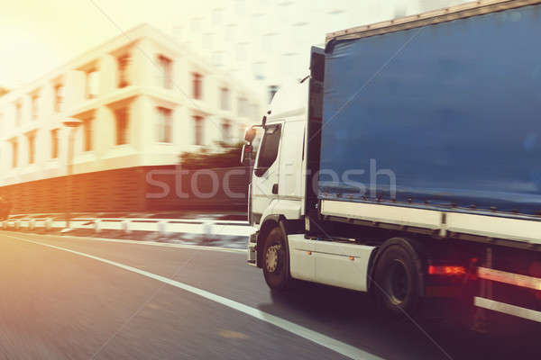 Fast truck on a city road delivering Stock photo © alphaspirit