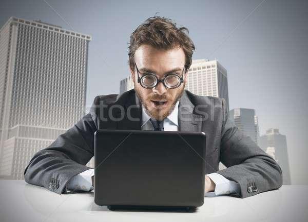 Nerd imprenditore lavoro laptop desk business Foto d'archivio © alphaspirit