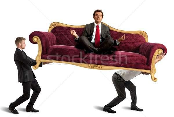 Boss doing yoga on sofa Stock photo © alphaspirit