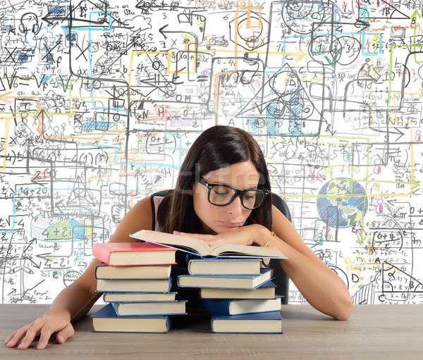 Bored student reads books Stock photo © alphaspirit