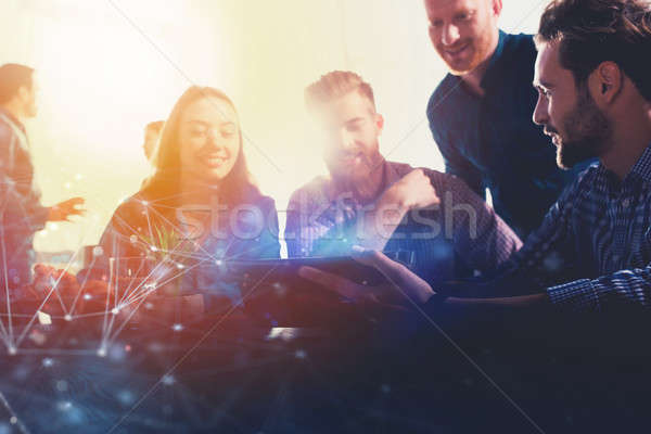 Businessperson in office connected on internet with a laptop. concept of partnership and teamwork Stock photo © alphaspirit