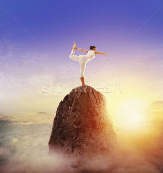 Yoga on top of the mountain Stock photo © alphaspirit