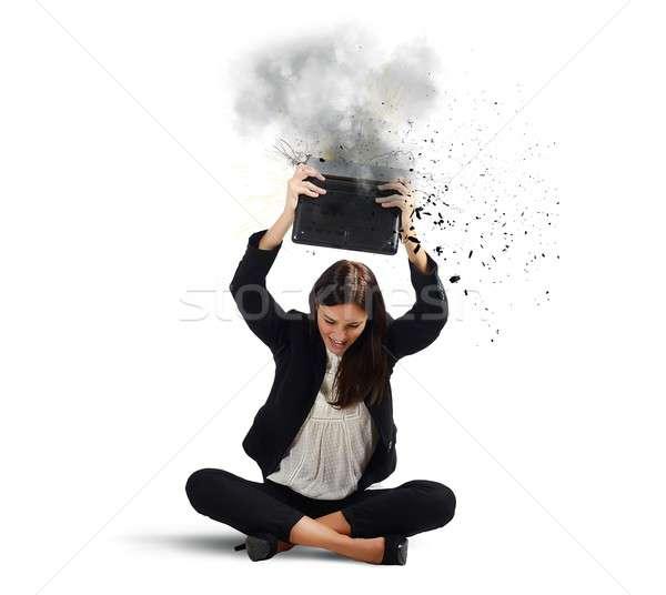 Businesswoman breaks her laptop Stock photo © alphaspirit