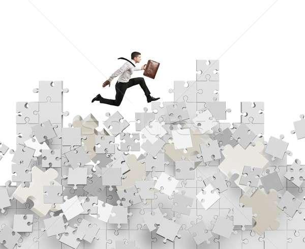 Businessman overcomes crisis Stock photo © alphaspirit