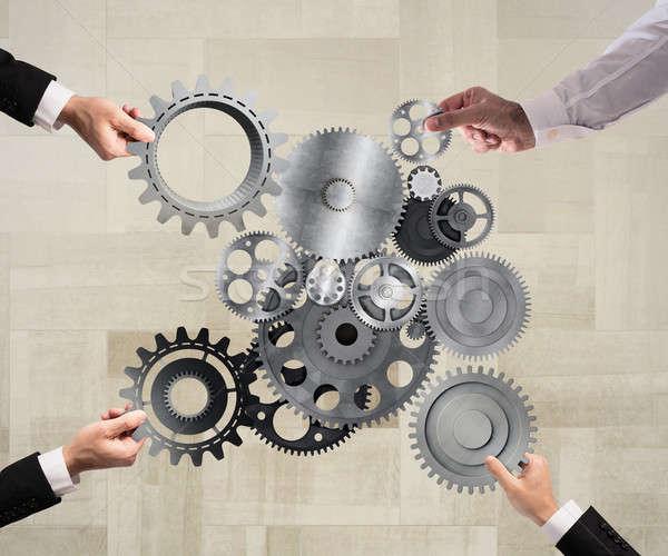 Teamwerk integratie werk samen stukken Stockfoto © alphaspirit