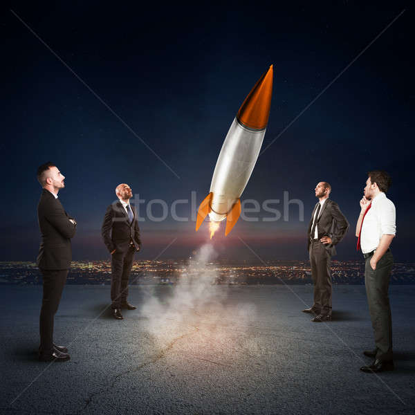 Team of businesspeople looks start a missile. Concept of company startup and new business. 3D Render Stock photo © alphaspirit