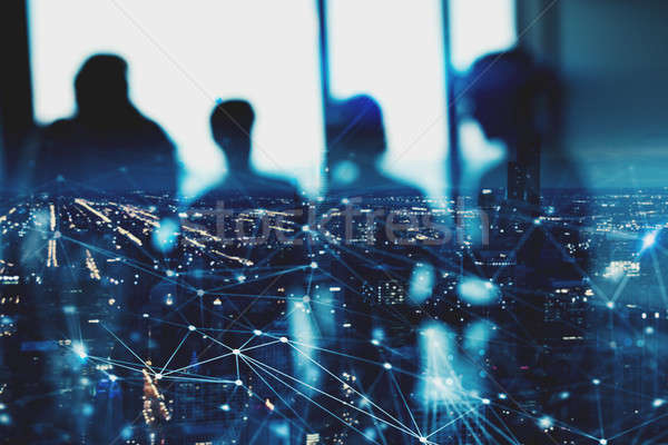 Blurred silhouette of businessperson in office with network effect. concept of partnership and teamw Stock photo © alphaspirit