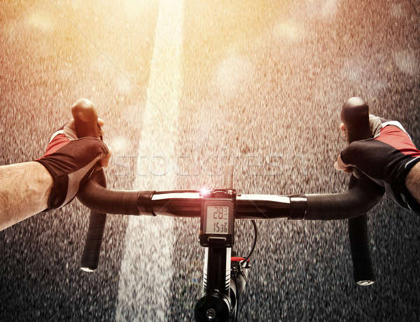 Cyclist pedaling the bike on a street in daylight Stock photo © alphaspirit