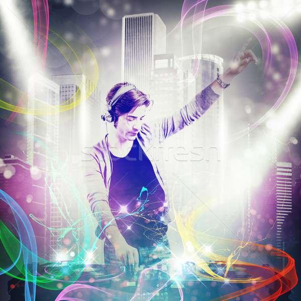 Dj mixing the music Stock photo © alphaspirit