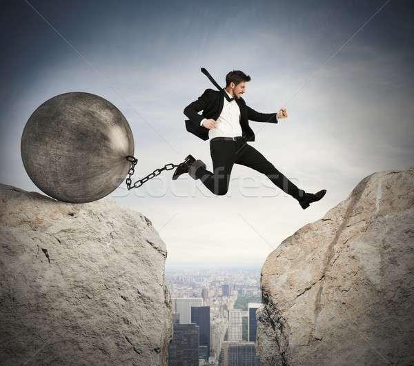 Businessman overcomes obstacles Stock photo © alphaspirit