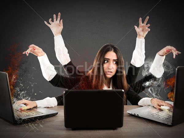 Stressed multitasking secretary Stock photo © alphaspirit