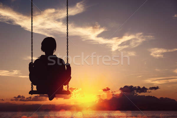 Freedom and carefree of a young female on a swing Stock photo © alphaspirit