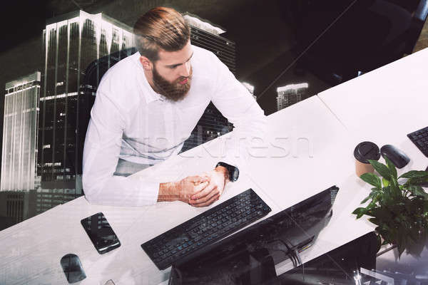 Businessman in office connected on internet network. concept of startup company. double exposure Stock photo © alphaspirit