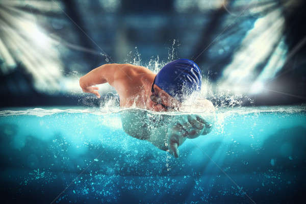 Athlete swims in a blue deep pool Stock photo © alphaspirit
