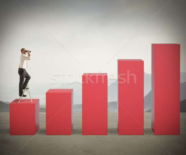 Businessman looks for success Stock photo © alphaspirit