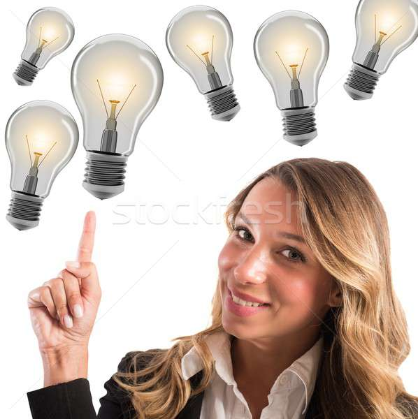 Businesswoman with lots of ideas Stock photo © alphaspirit