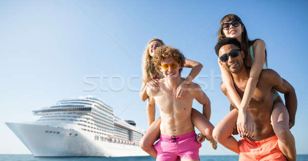 Happy smiling couples who travel by cruiseship. Concept of holiday and summertime Stock photo © alphaspirit