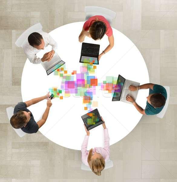 üzleti csapat együttműködik együtt osztás munka projektek Stock fotó © alphaspirit