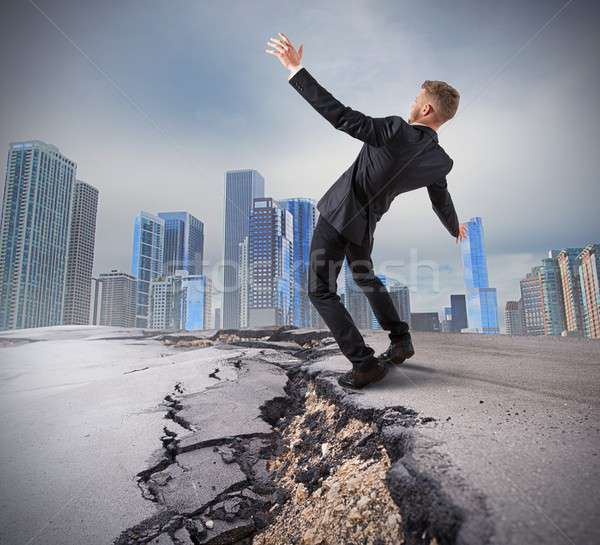 Businessman trying to overcome a deep break Stock photo © alphaspirit