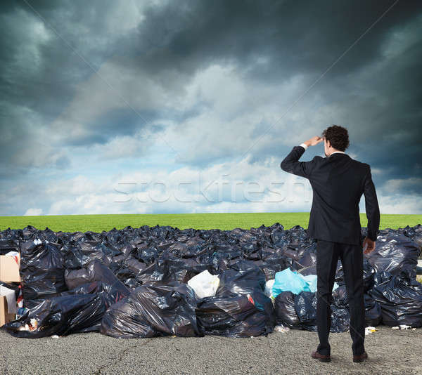 Businessman searches far for clean environment. overcome the global pollution problem Stock photo © alphaspirit