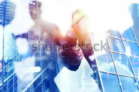 Businessman Architect analyzes the works of a building. double exposure Stock photo © alphaspirit