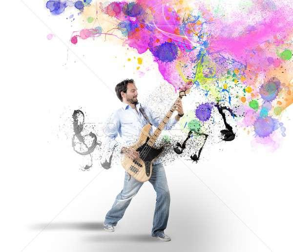 Erkek bas gitar oynamak renkli etki Stok fotoğraf © alphaspirit