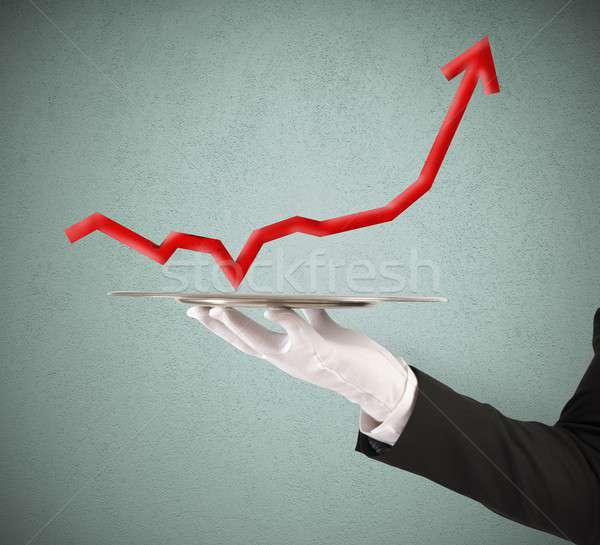 Businessman holds a tray with statistics Stock photo © alphaspirit