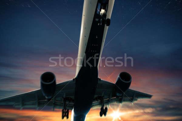 航空機 飛行 日没 空 太陽 光 ストックフォト © alphaspirit