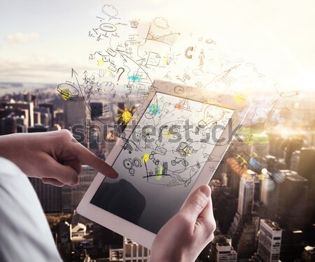 Businessman working with tablet and social media Stock photo © alphaspirit