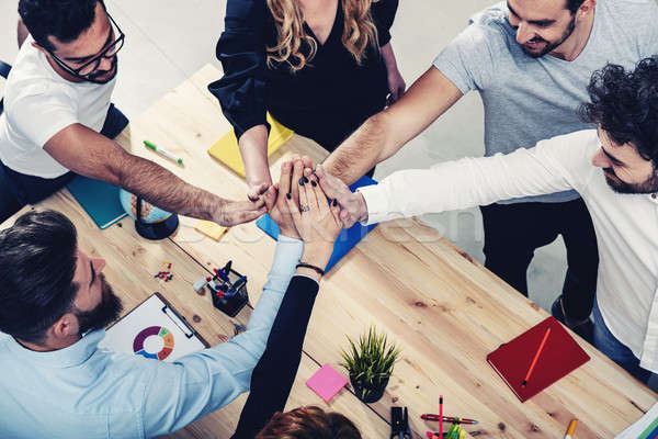 Business people putting their hands together. Concept of integration, teamwork and partnership Stock photo © alphaspirit